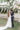 bride and groom kiss at their outdoor wedding reception in Greece