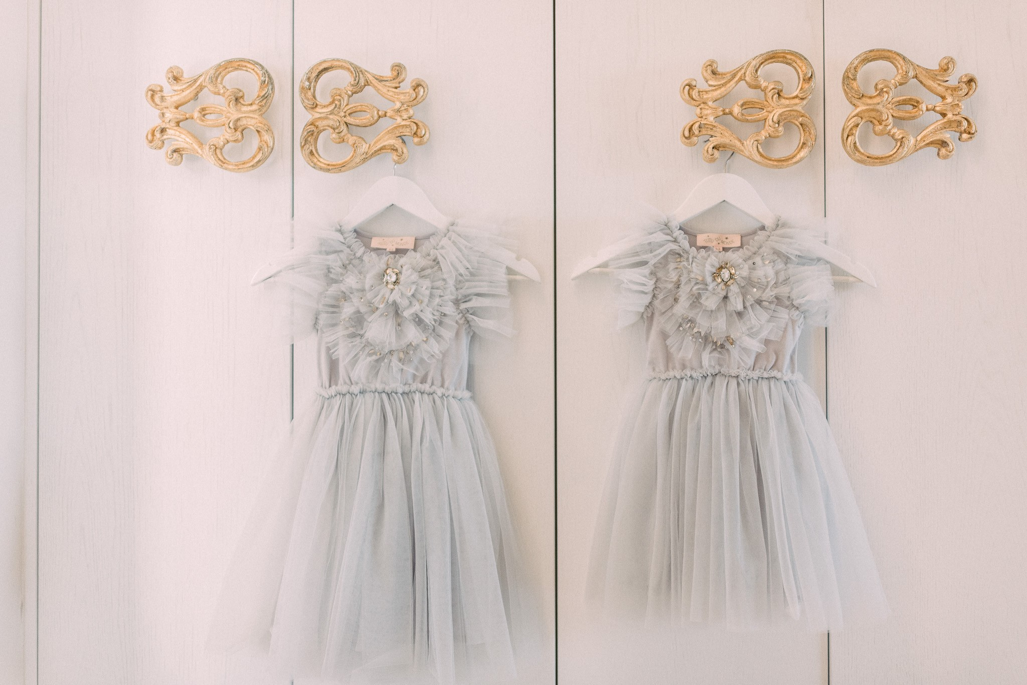 dusty blue flower girl dresses with ruffled tulle and beaded accents