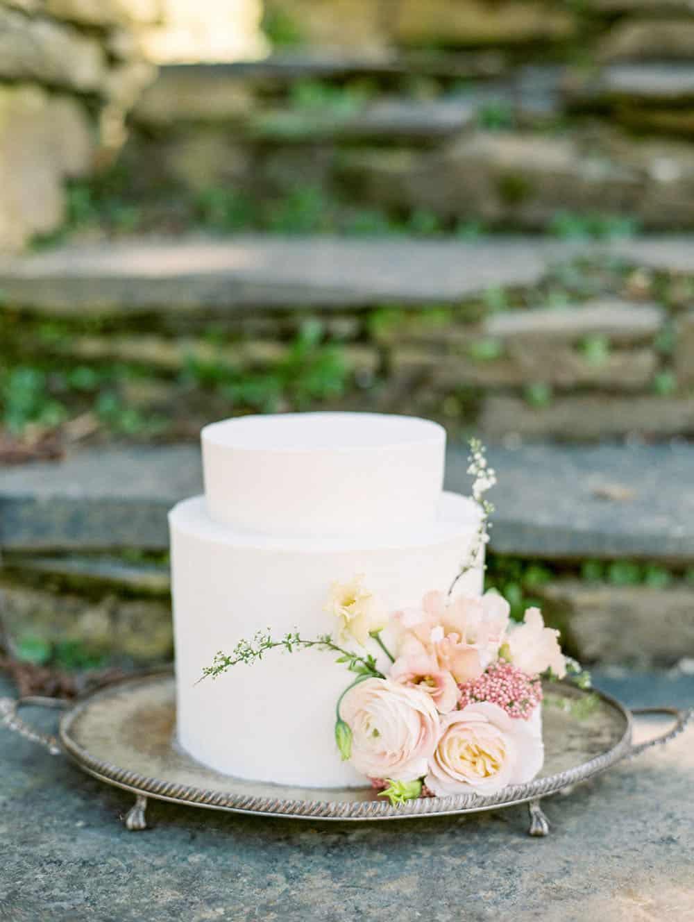 spring buttercream cake with seasonally inspired wedding flowers