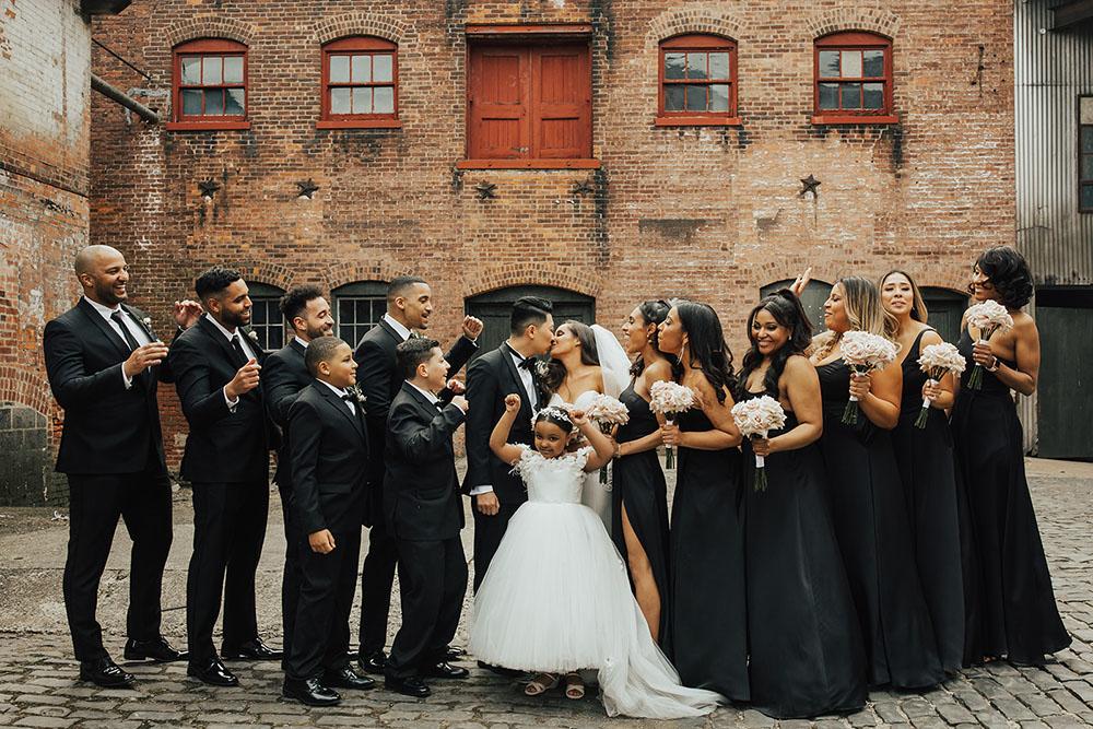 brick exterior bridal party portraits at an art factory wedding venue