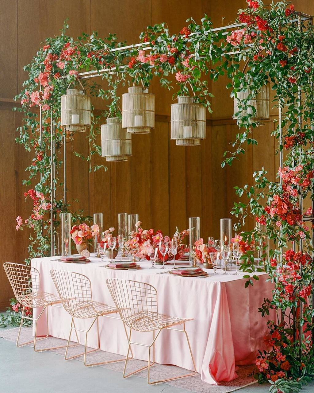pink wedding tablescape with gold lighting