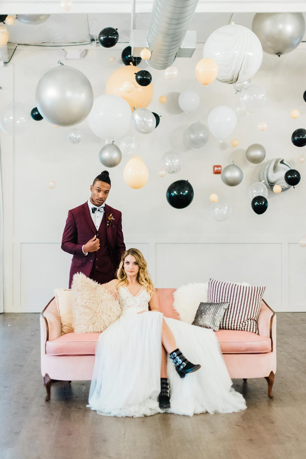 balloon ceiling wedding backdrop bride and groom with pink sofa