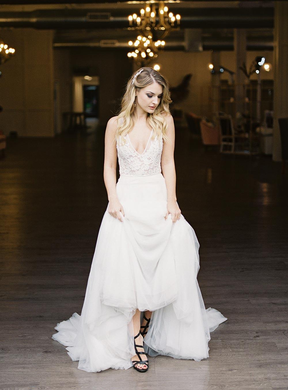 plunging neckline wedding dress and half up half down bridal hairstyle