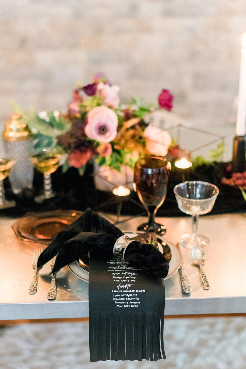 black leather wedding menus and grungy tablescape