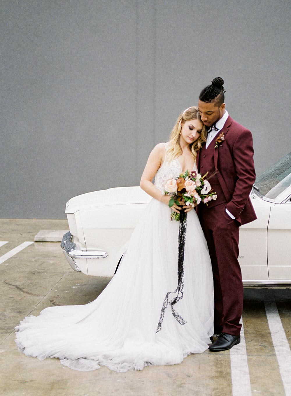 dark red groom suit and black leather bridal jacket with mustang convertible