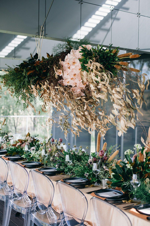 wispy floral installation at wedding reception