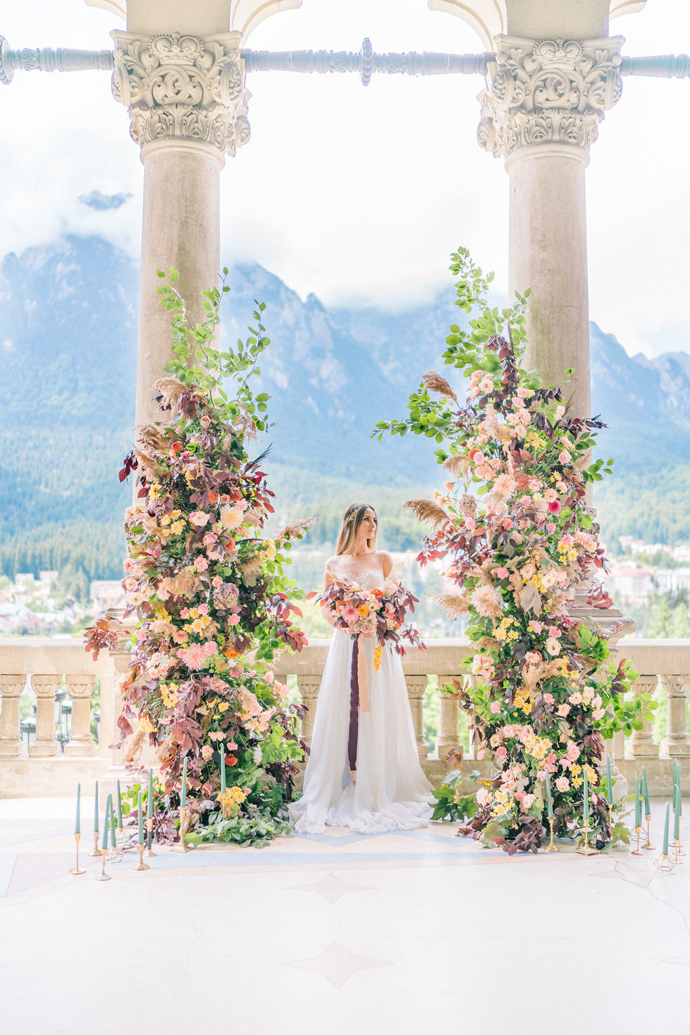 bridal portrait in front of the ceremony arch