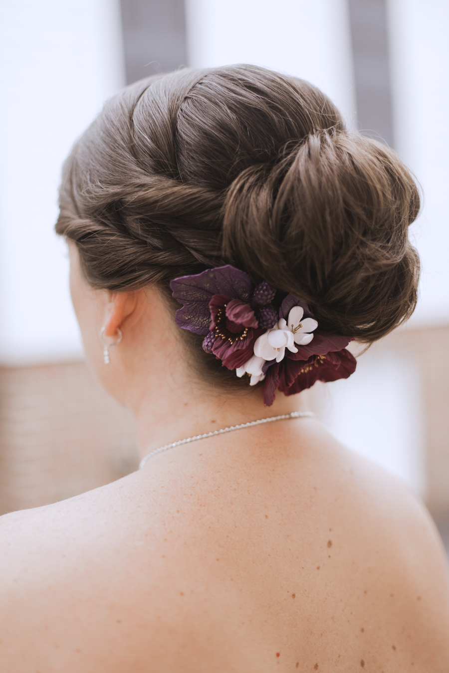 purple bridal hair accessories - https://ruffledblog.com/rustic-woodland-chic-wedding-inspiration-in-baltimore