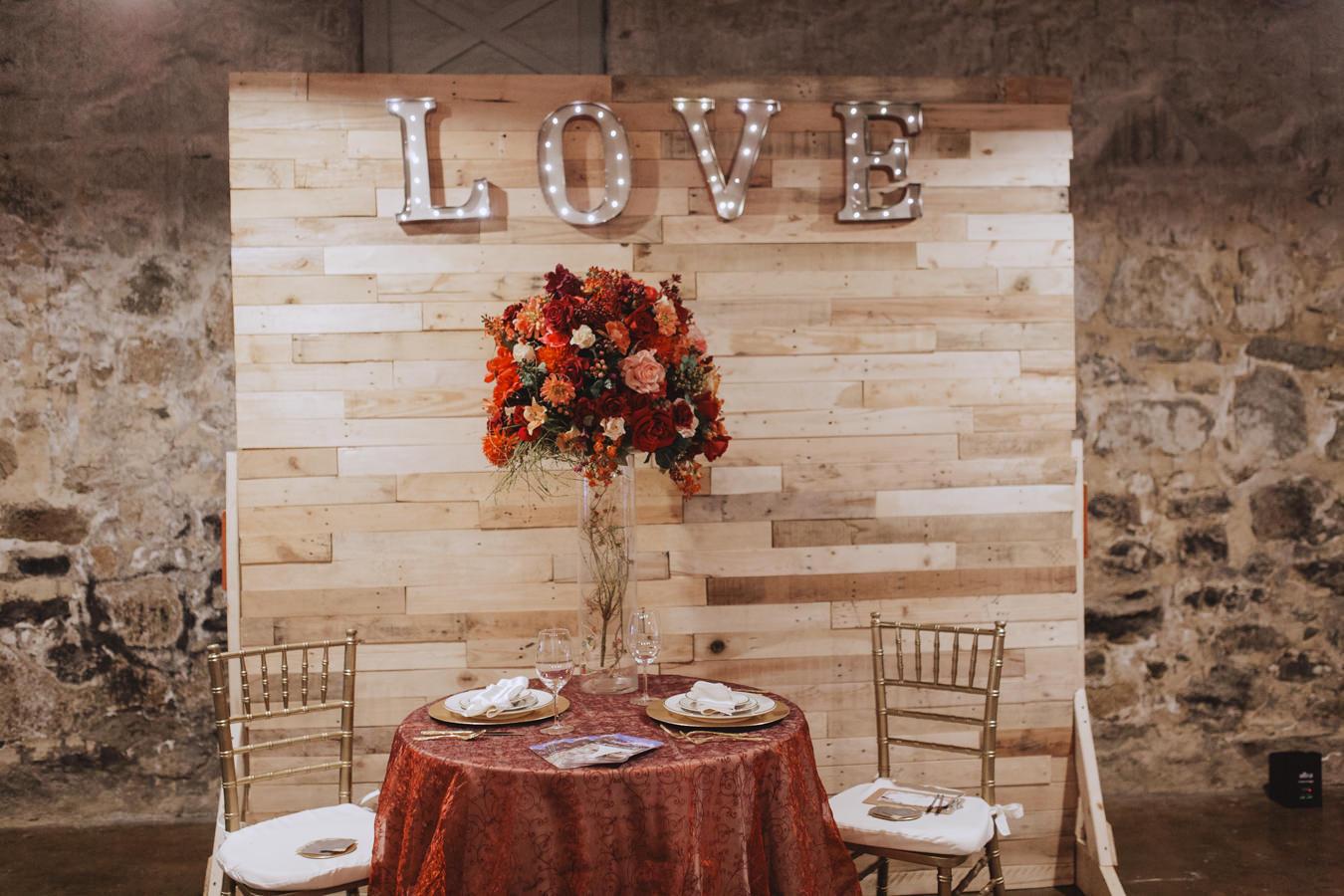 rustic fall sweetheart tables - https://ruffledblog.com/rustic-woodland-chic-wedding-inspiration-in-baltimore