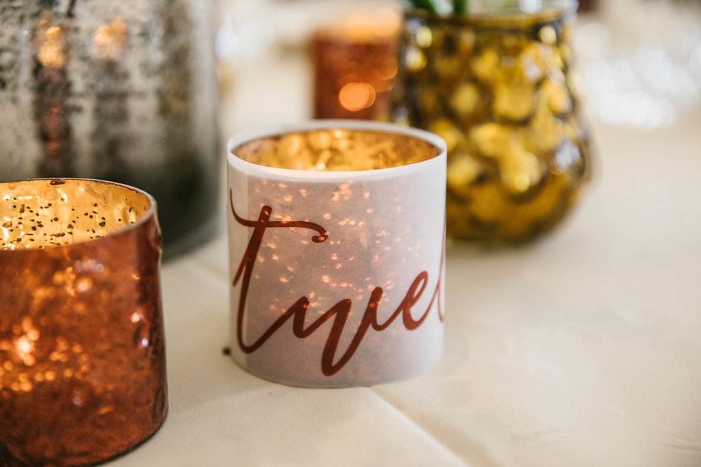 candle table numbers - http://ruffledblog.com/vibrant-atlanta-wedding-inspiration-with-rust-accents