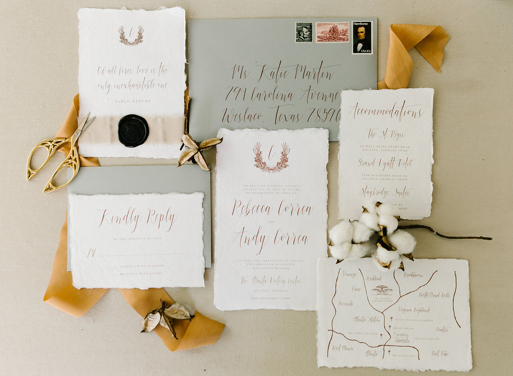 fall wedding invitation suites - http://ruffledblog.com/vibrant-atlanta-wedding-inspiration-with-rust-accents