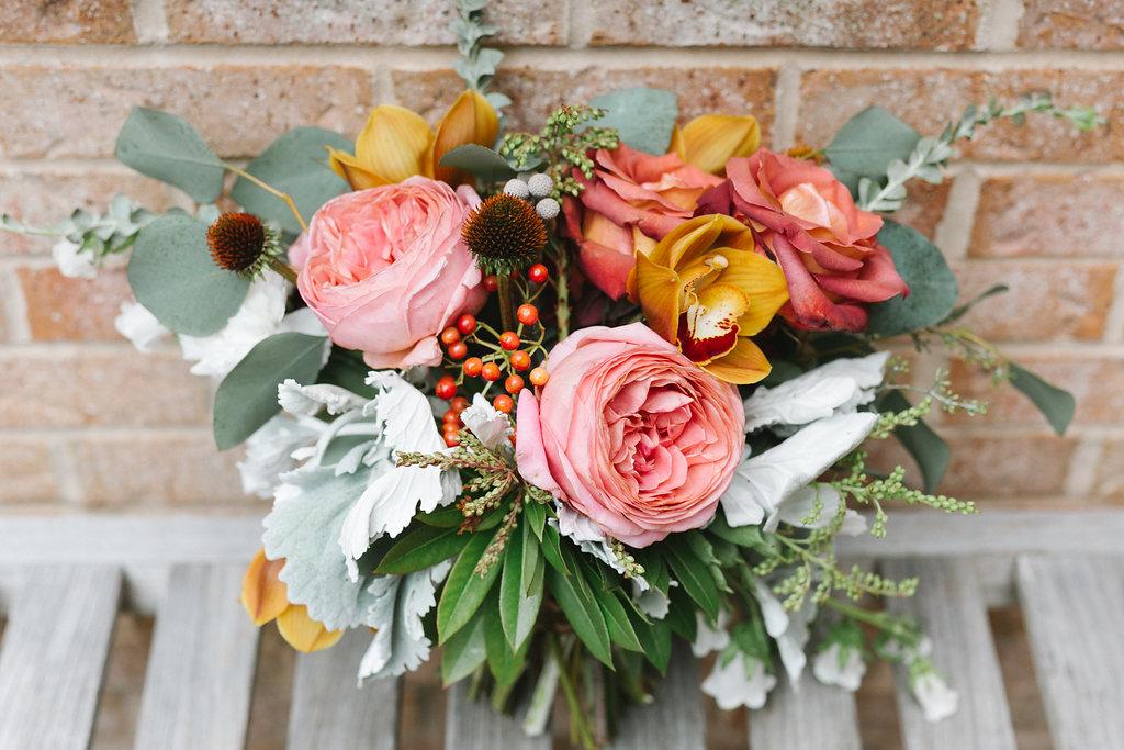 pink and yellow wedding flowers - https://ruffledblog.com/vibrant-atlanta-wedding-inspiration-with-rust-accents