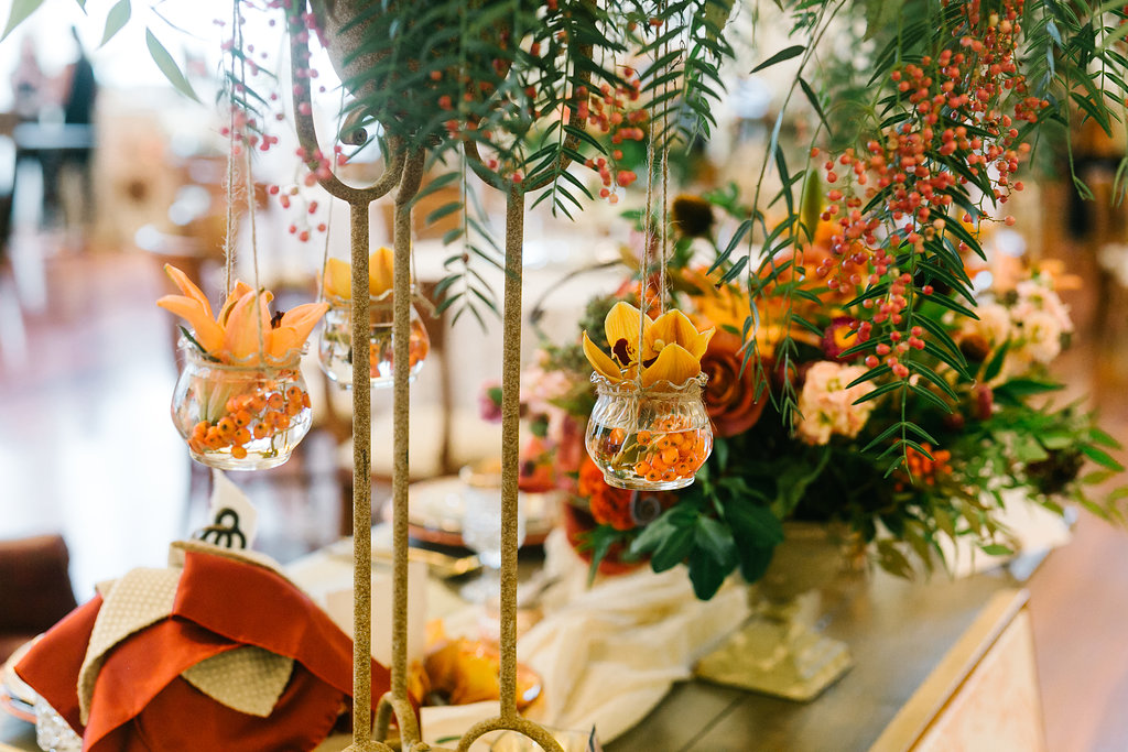 orange wedding ideas with greenery - https://ruffledblog.com/vibrant-atlanta-wedding-inspiration-with-rust-accents