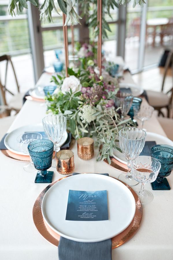 blue and copper tablescape ideas - photo by Studio Twelve 52 https://ruffledblog.com/california-coast-inspired-wedding-ideas