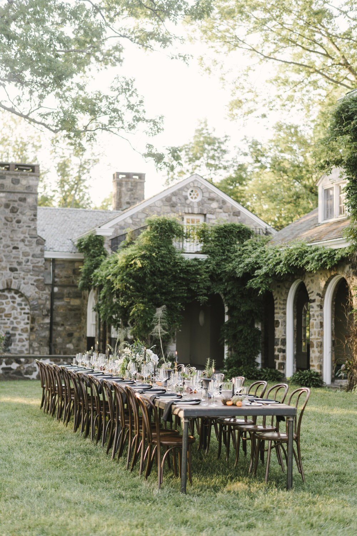 wedding garden reception with wooden roman table
