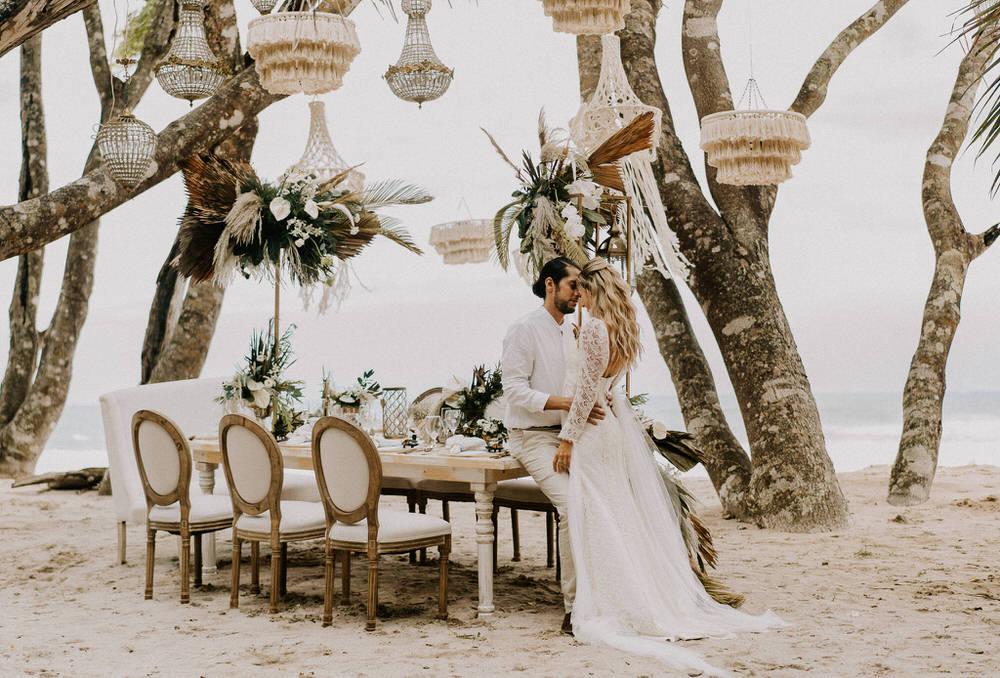 bride and groom at their boho chic reception setup
