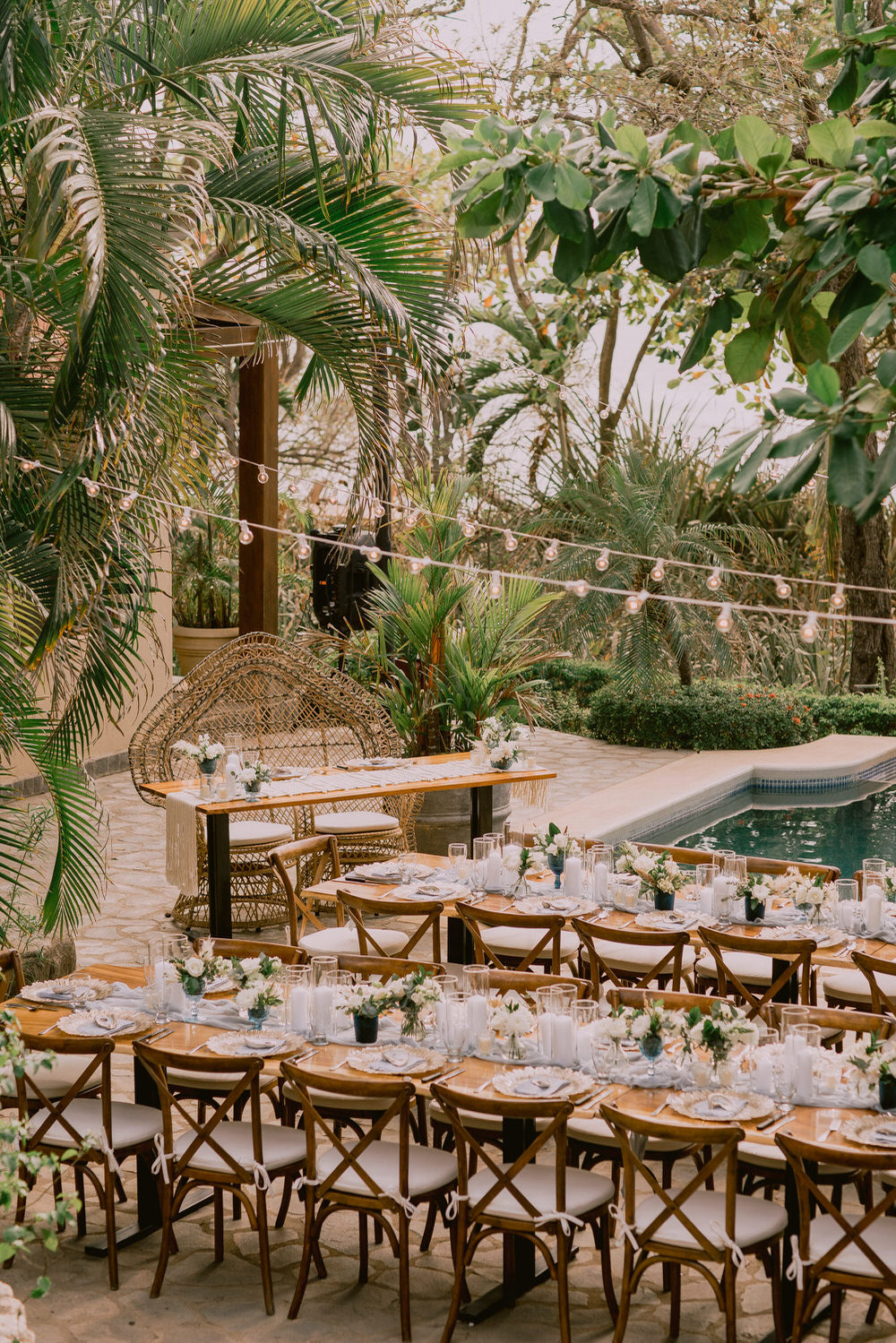 wedding reception decor with market lights by a pool