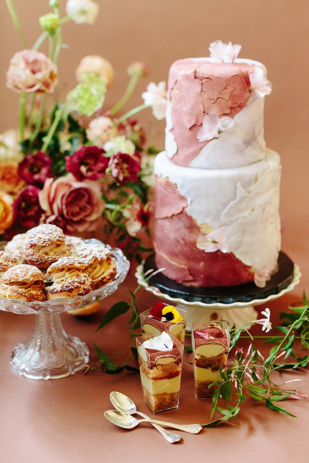 textured two tier cake with desserts