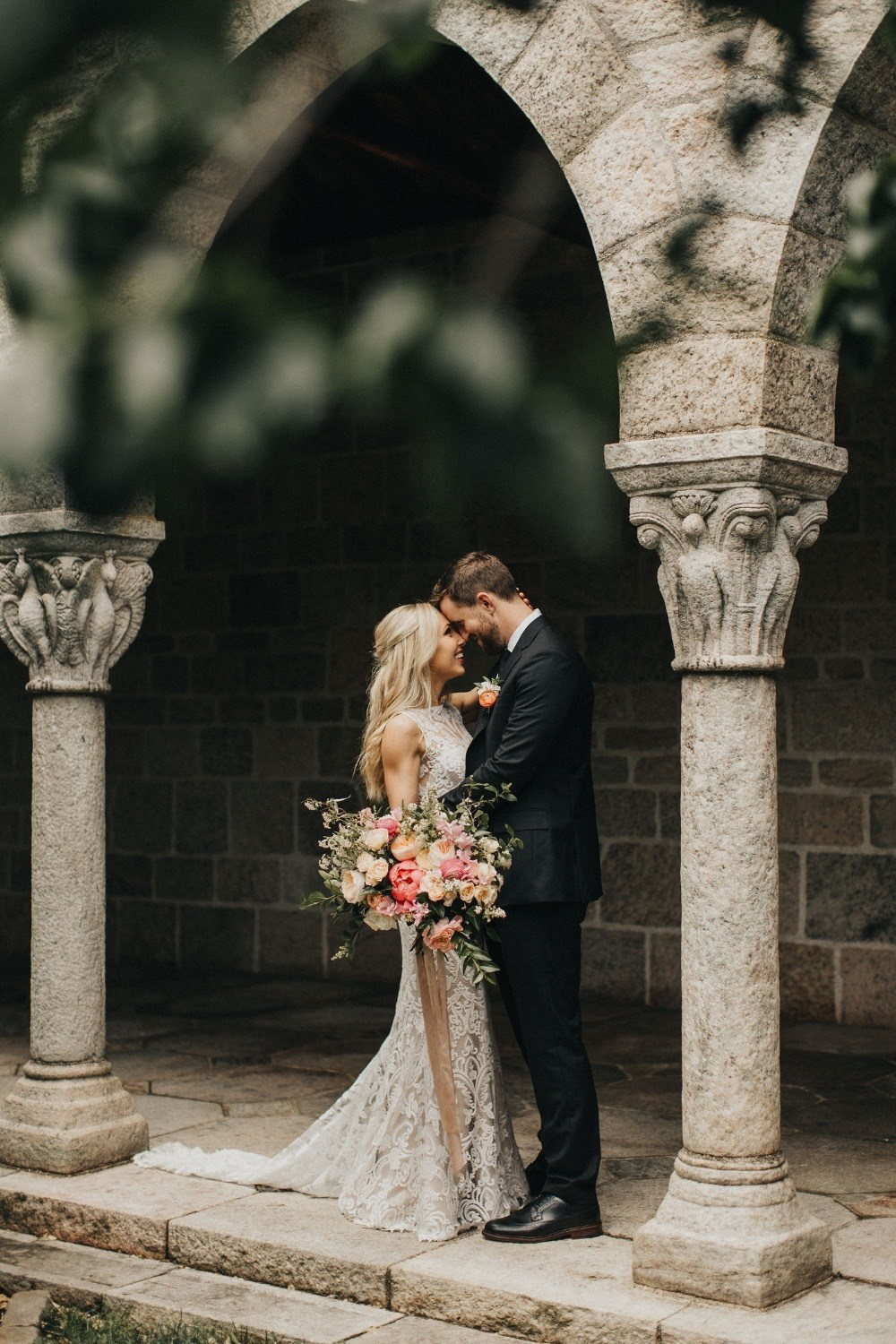 bride and groom share a moment in a secret garden
