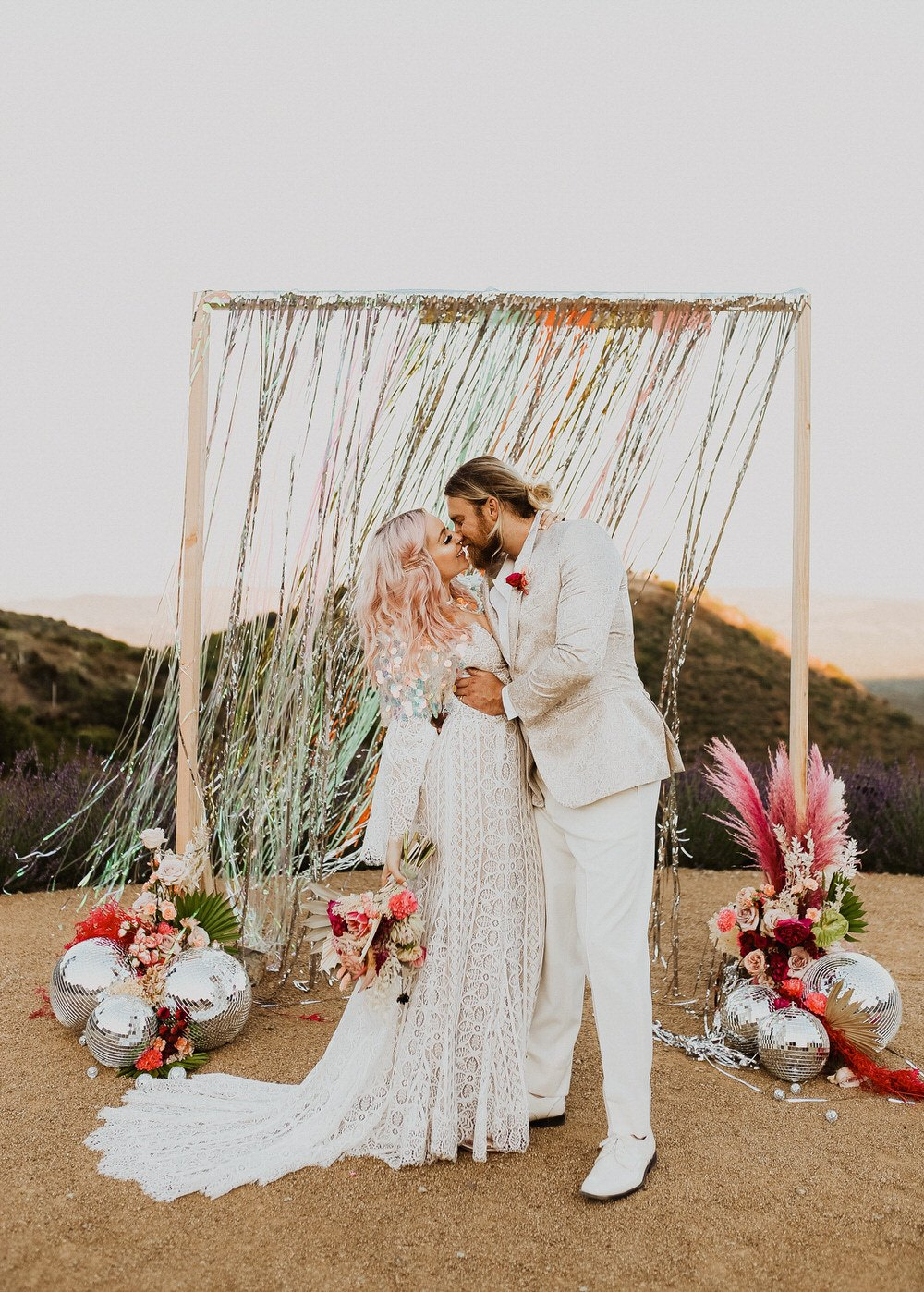 bride and groom kiss during their California ceremony
