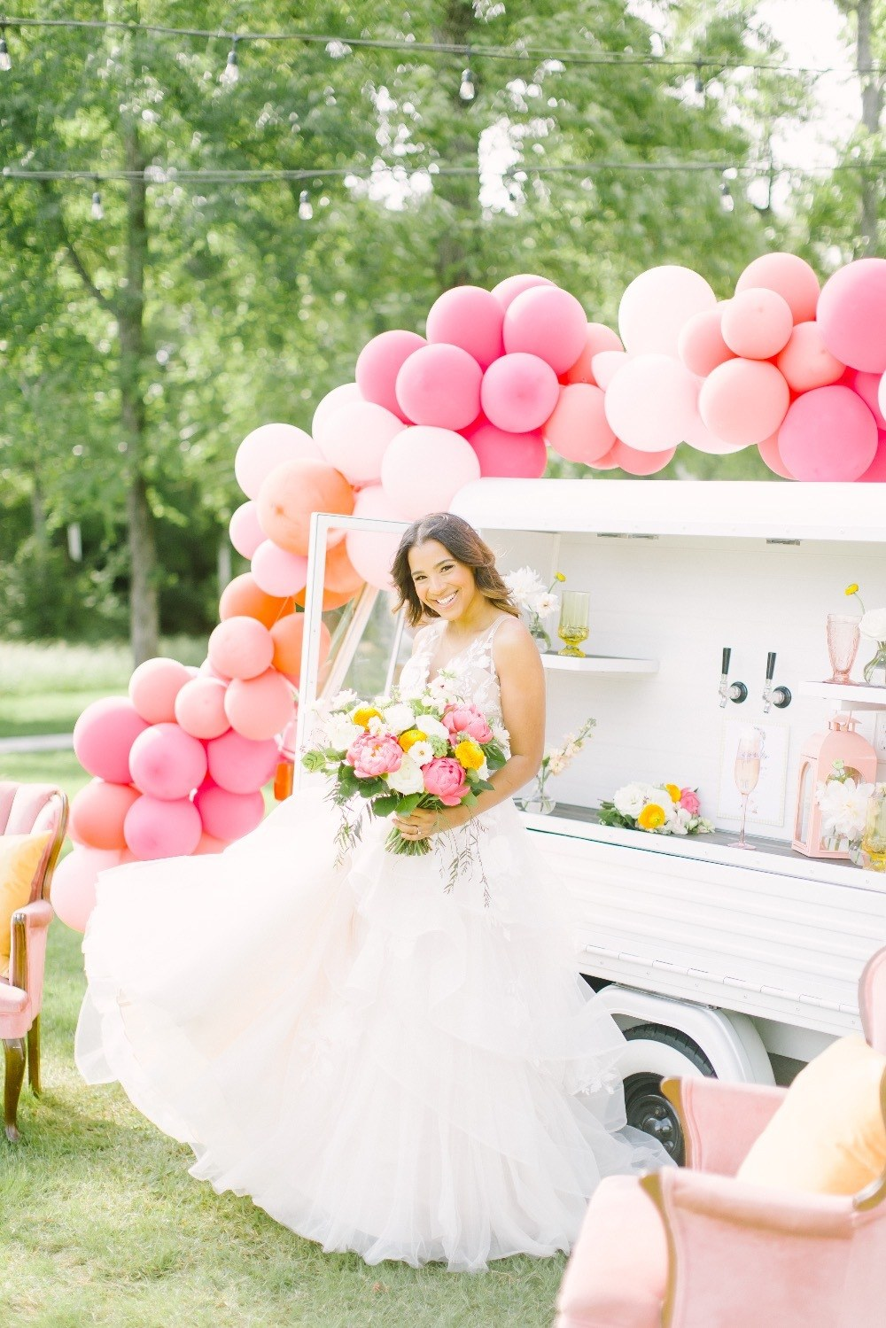 bride twirling in front of mobile bar