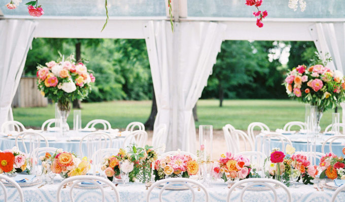 drippy florals hang over the head table at the reception