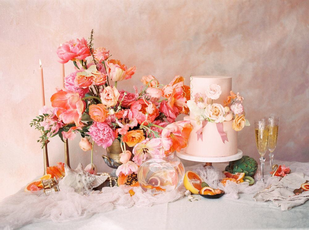pink everything wedding cake and floral arrangement