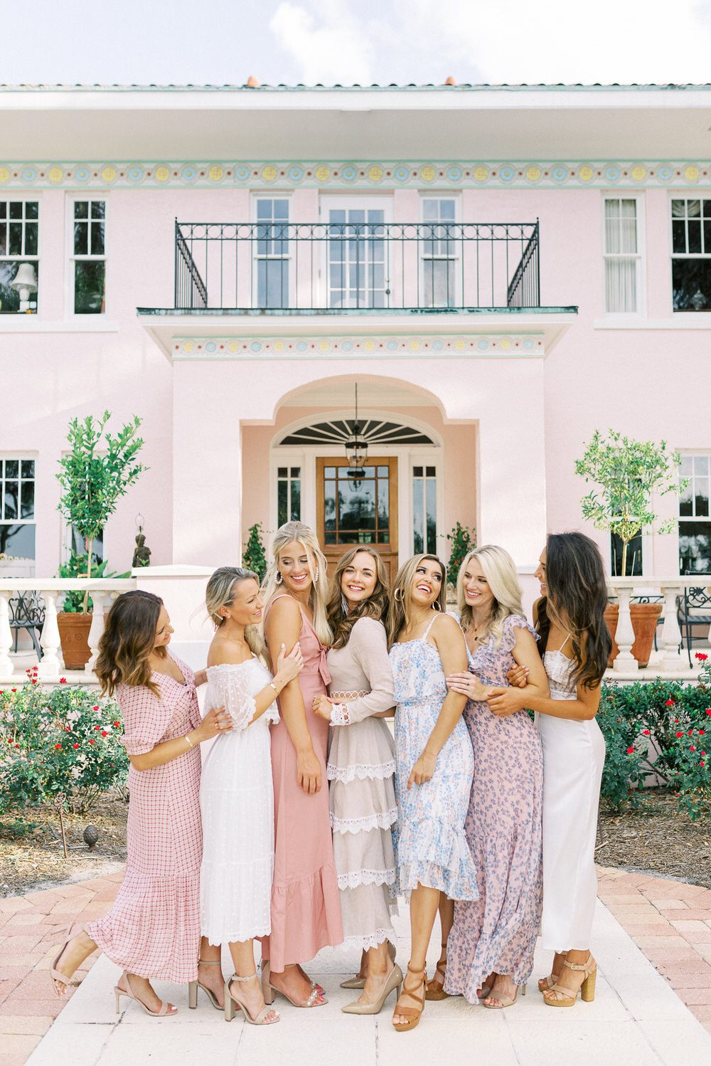 bride with her bridesmaids in cute flirty dresses