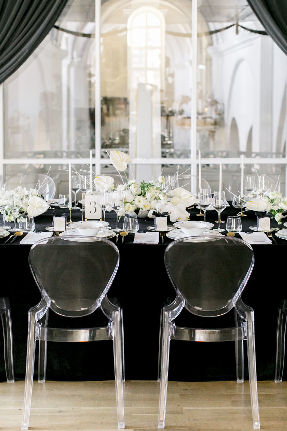 black and white wedding decor with ghost chairs