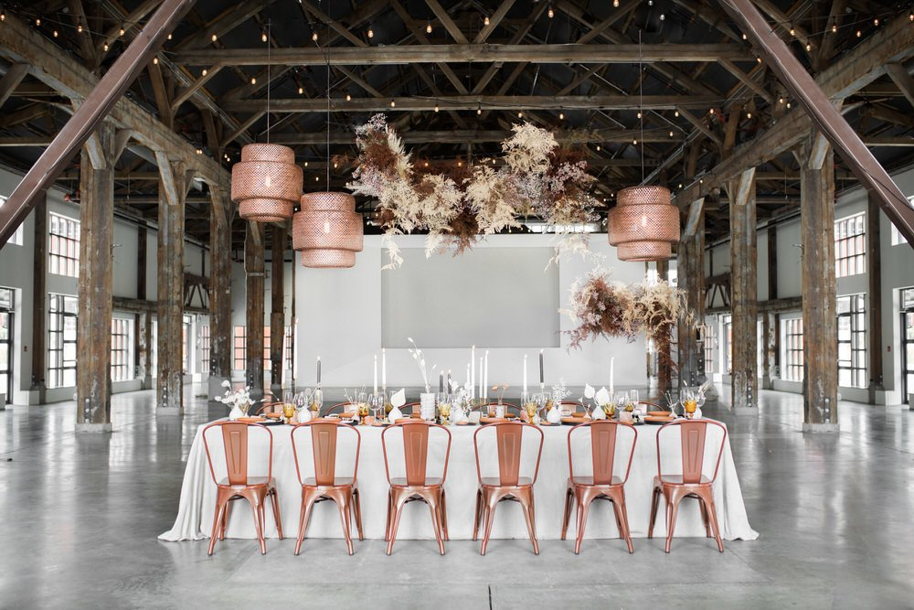 Industrial wedding with hanging floral installation