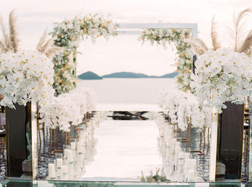 orchids line the aisle in Phuket wedding