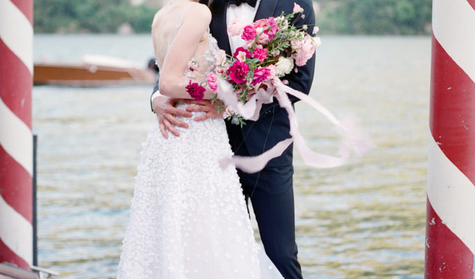 bride and groom portrait on the dock on Lake Como