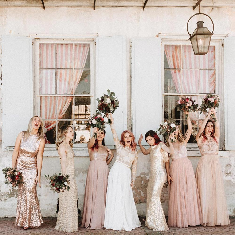 mismatched bridesmaid dresses and bride with pink hair