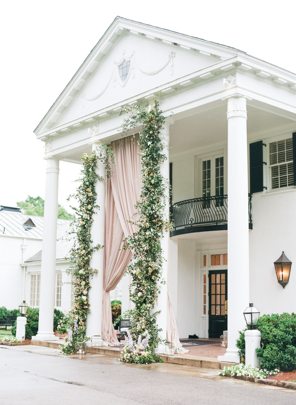 massive blush wedding draping at reception entrance