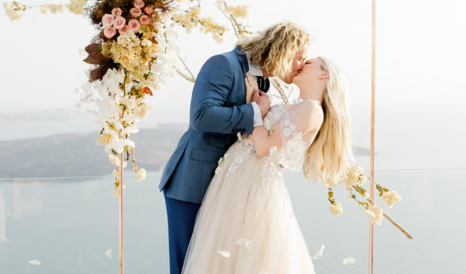 bride and groom kiss during the ceremony