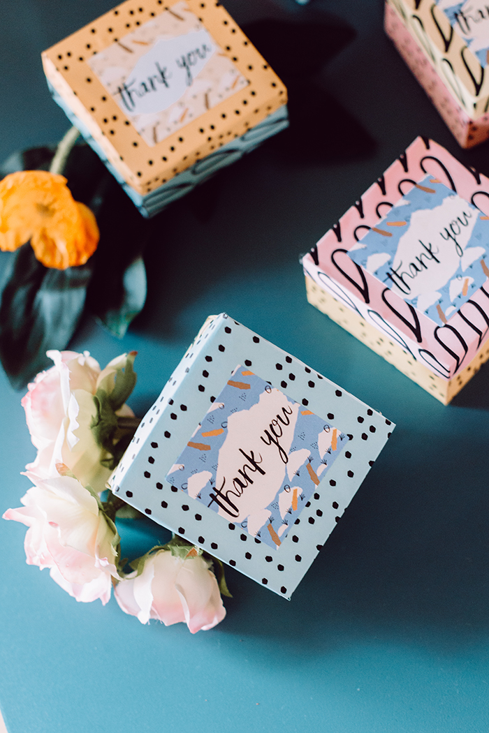 free gift wrap pattern and thank you labels for wedding favors - photo by Clarence Chan Photography http://ruffledblog.com/diy-origami-favor-boxes-free-printables