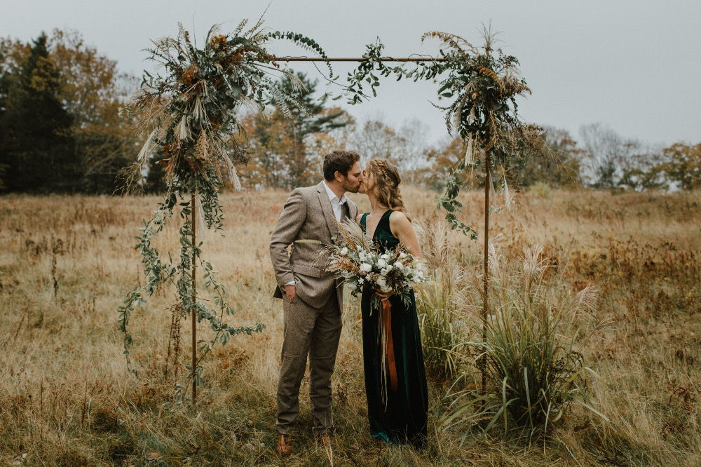 Rustic Topsl Farm bride and groom kissing