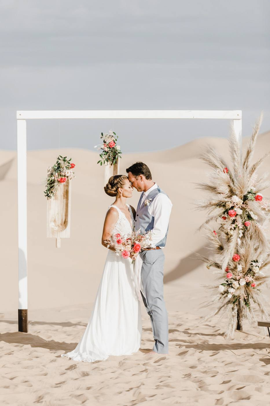 bride and groom in the desert for wedding ceremony