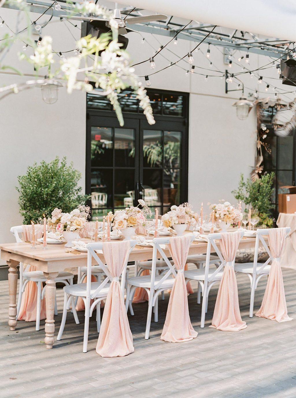 garden reception wedding tablescape with peach linens