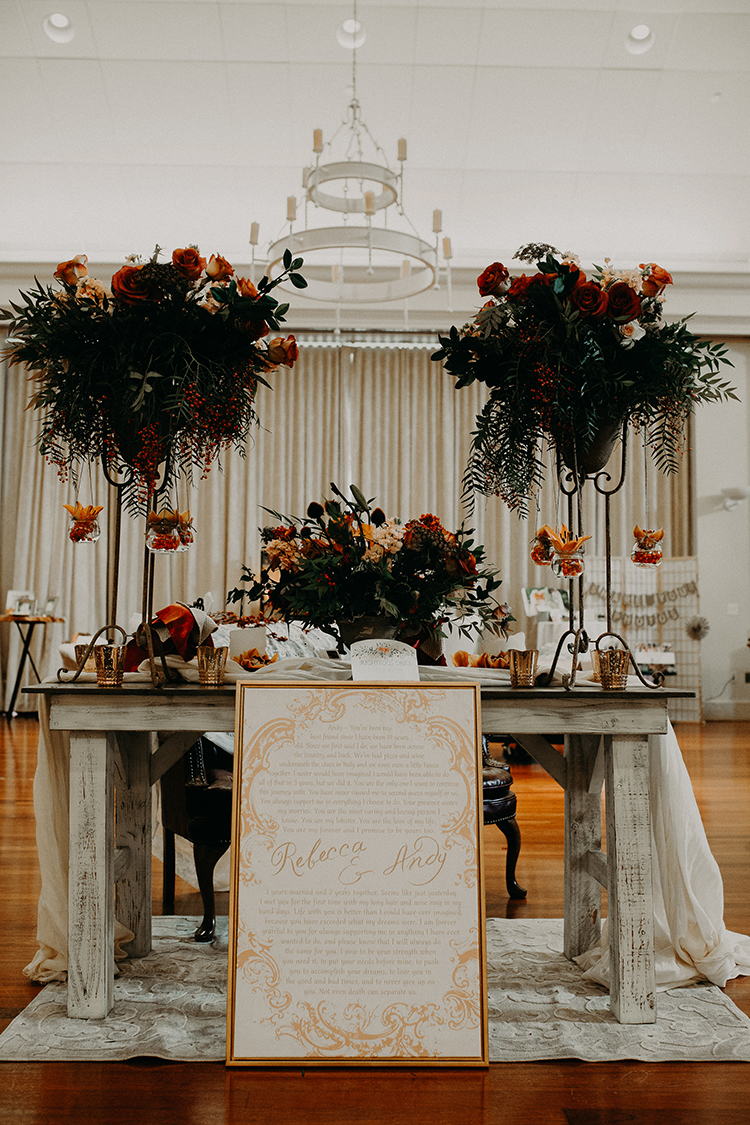 indoor fall weddings with orange - http://ruffledblog.com/vibrant-atlanta-wedding-inspiration-with-rust-accents