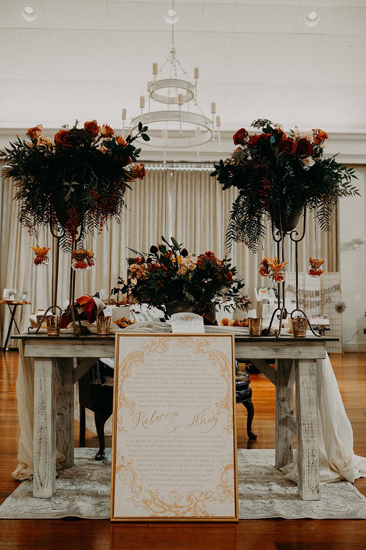indoor fall weddings with orange - https://ruffledblog.com/vibrant-atlanta-wedding-inspiration-with-rust-accents
