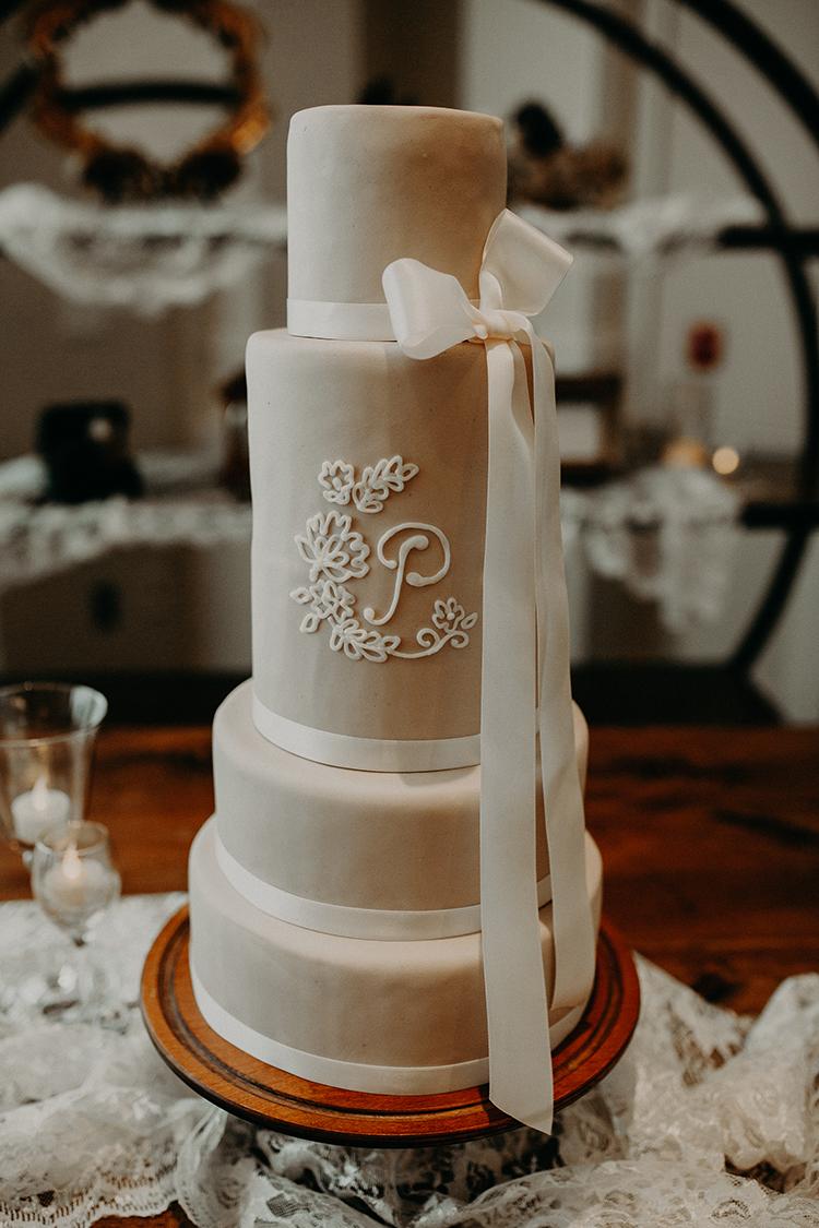 beige wedding cakes - https://ruffledblog.com/vibrant-atlanta-wedding-inspiration-with-rust-accents