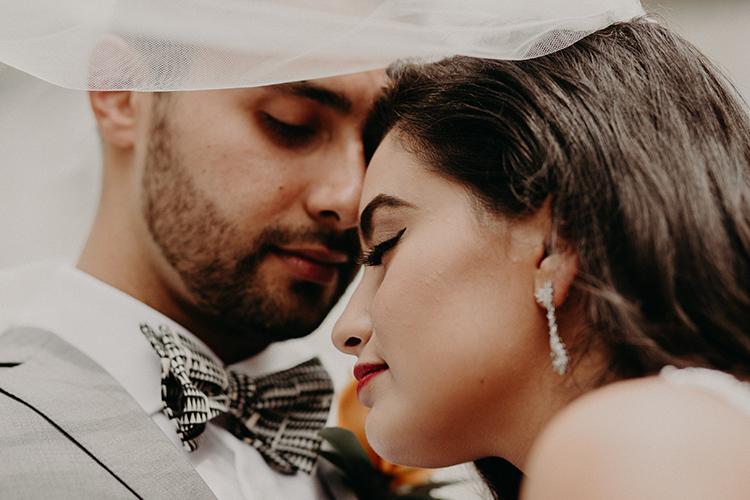 wedding portraits with veils - https://ruffledblog.com/vibrant-atlanta-wedding-inspiration-with-rust-accents