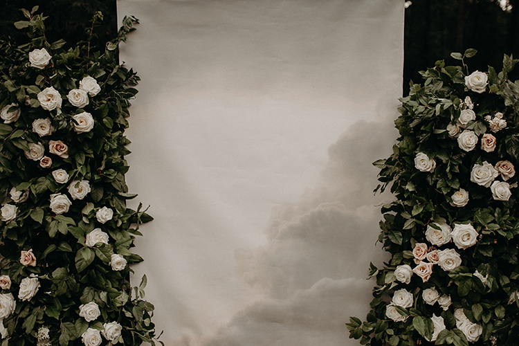 photo wedding backdrop with clouds - http://ruffledblog.com/vibrant-atlanta-wedding-inspiration-with-rust-accents
