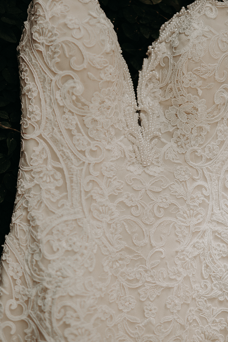 intricate lace wedding gowns - http://ruffledblog.com/vibrant-atlanta-wedding-inspiration-with-rust-accents