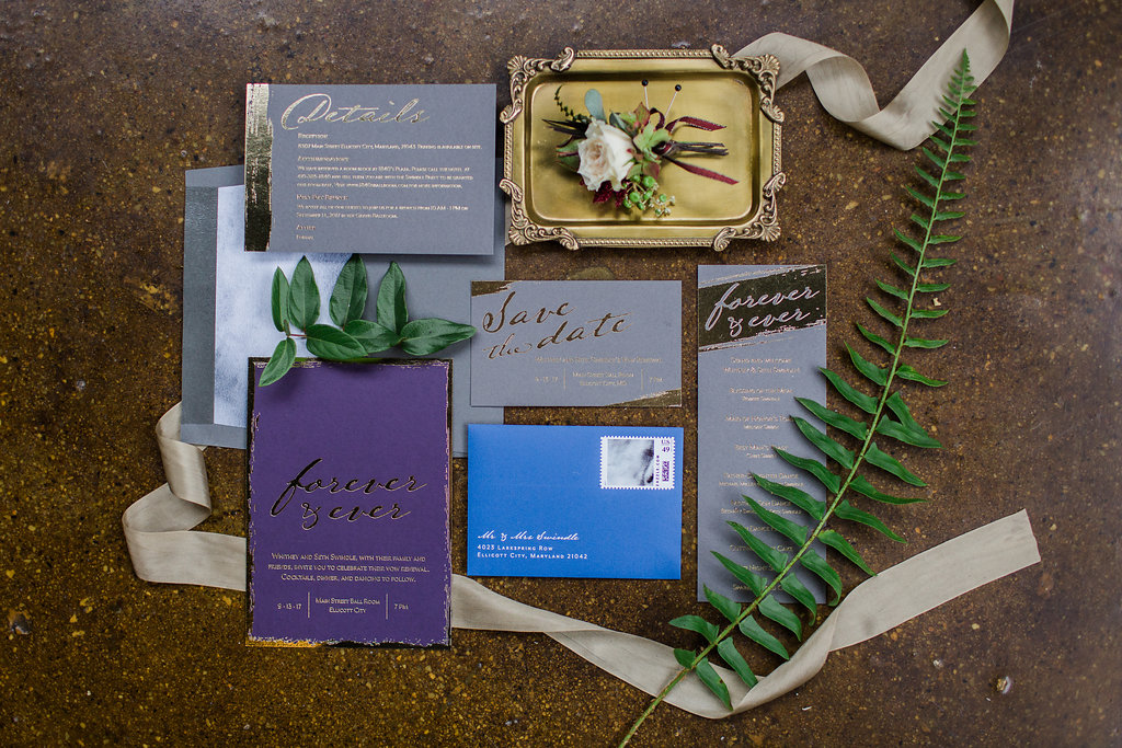 purple and grey wedding invitations with gold accents - https://ruffledblog.com/rustic-woodland-chic-wedding-inspiration-in-baltimore