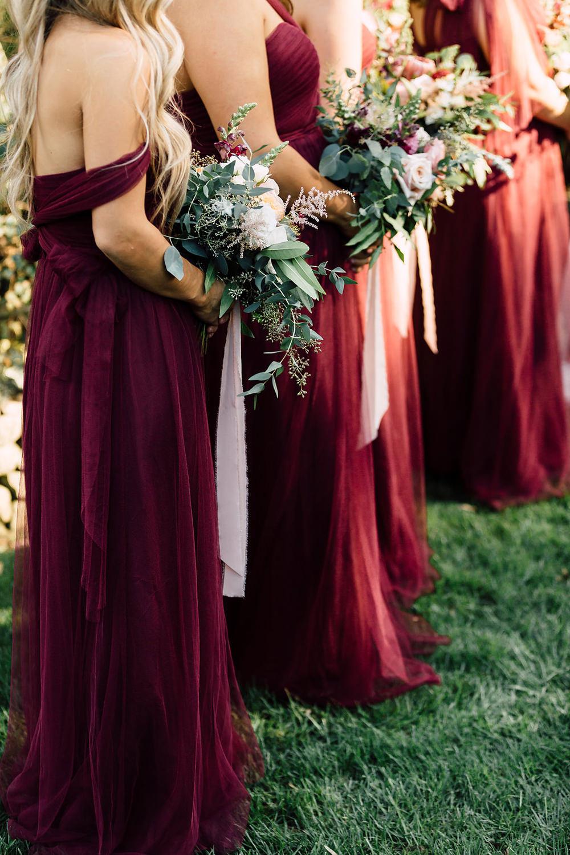 bridesmaids during ceremony - photo by Plum and Oak https://ruffledblog.com/a-california-garden-wedding-with-romantic-florals