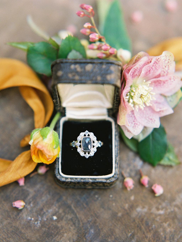 unique vintage engagement rings - photo by Charla Storey https://ruffledblog.com/architectural-san-antonio-mission-wedding-inspiration