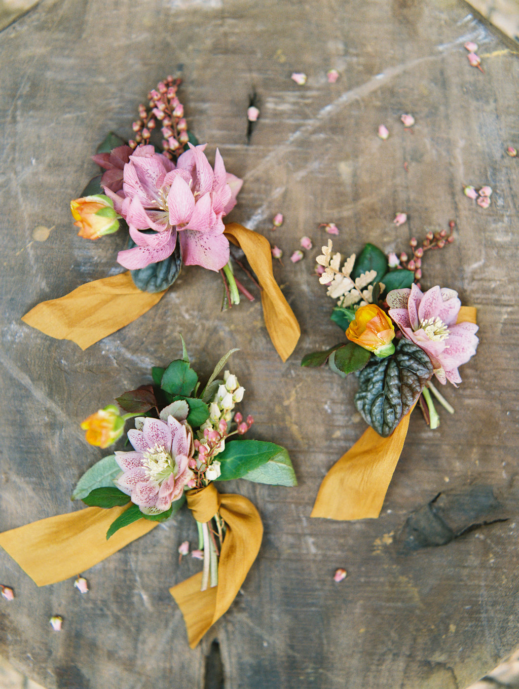 pink and yellow boutonnieres - photo by Charla Storey http://ruffledblog.com/architectural-san-antonio-mission-wedding-inspiration