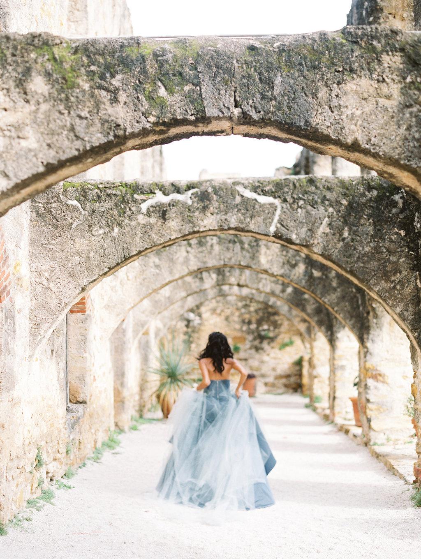 blue wedding dresses - photo by Charla Storey https://ruffledblog.com/architectural-san-antonio-mission-wedding-inspiration